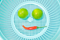 Smile, Lemon and chili in plastic basket, food ingredient Stock Photo