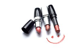 Smile and lipsticks royalty free stock images