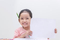 Smile little asian girle showing blank paper Stock Images