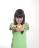 The smile little girl with apple Stock Photo