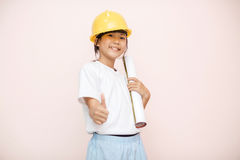 Smile little girl as architect engineer dream to future shows go Stock Image