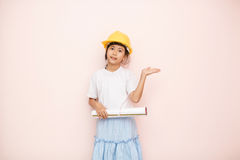 Smile little girl as architect engineer dream to future shows ha Stock Photos