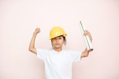 Smile little girl as architect engineer dream to future shows ha Royalty Free Stock Photo