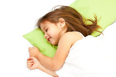 Smile little girl in bed. Cute little girl smiling in her bed Royalty Free Stock Images