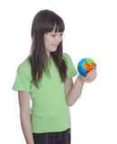 The smile little girl with globe. Isolated on a white background Royalty Free Stock Image
