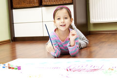Smile little girl with a paint brusher Stock Photography