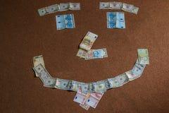 Smile made of cash Stock Photos