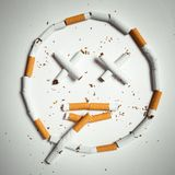 Smile, made of cigarettes Stock Photo