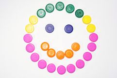 Smile. Made of plastic caps of different colors Stock Images