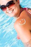 A smile made with suncream at the shoulder Stock Photography