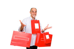 Smile man bring lot paper bags Stock Photography