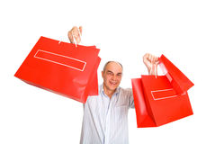 Smile man bring lot paper bags Stock Images