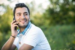 Smile man on mobile phone Stock Photos