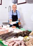 Smile man selling frozen fish Stock Photo