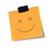 Smile message on adhesive note Royalty Free Stock Images