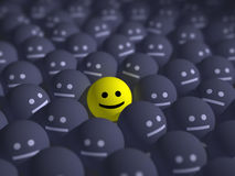 Smile in the middle of grey crowd royalty free stock photo
