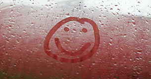 Smile. On the misted window Stock Photo