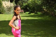 Smile from mixed race young girl in park sunshine Stock Photography