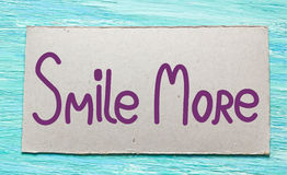 Smile more. Inspirational quote handwritten brush, royalty free stock photos