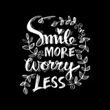 Smile more worry less. Stock Photo