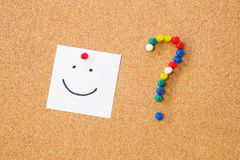 Smile note pinned to cord board. Stock Image