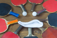 Smile in the old rackets for table tennis. Rackets and balls lie on the floor in a smile Royalty Free Stock Photos
