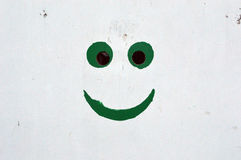 Smile. On the old wall Royalty Free Stock Photos