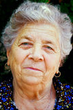 Smile of one content happy senior old woman Royalty Free Stock Photos