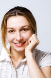 Smile of one cute content young woman Royalty Free Stock Image