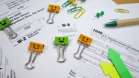 Smile Binder Clips with Pen on W-2 and W-9, 1040 Tax Form