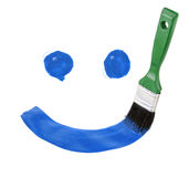 Smile paint drawing with brush. Isolated on white background Stock Image