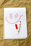 Smile. On paper painted smiley red felt-tip pen Stock Illustration