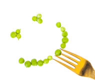 Smile of peas on a fork grain Royalty Free Stock Images