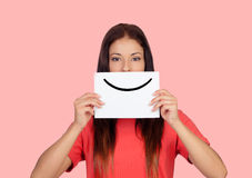 Smile please. Woman holding a banner with a smile isolated on white background Stock Images