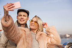 Positive girlfriend and boyfriend are taking photo stock photo