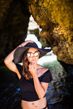 Smile pretty mexican girl posing inside beach cave on summer vocation Royalty Free Stock Images