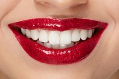 Smile With Red Lips And White Teeth. Close Up Of Smiling Woman`s Mouth With Red Lipstick Makeup On Plump Full Sexy Lips And Healthy White Teeth. Beauty Anf Royalty Free Stock Photography