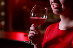Smile and red wine Royalty Free Stock Photography