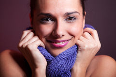 Smile and  scarf. Close-up of a beautiful young female with blue scarf. Studio shot taken with 5d mark II Royalty Free Stock Photos