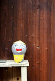 Smile sculpture and wood wall Stock Photography