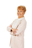 Smile senior woman with folded hands Royalty Free Stock Images