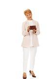 Smile senior woman holding wallet Stock Photo