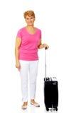 Smile senior woman with suitcase stock photo