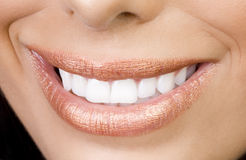 Smile sexy girl. Sexy feminine smiling mouth with perfect teetch and sensual lips Royalty Free Stock Image