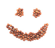 Smile shape made of hazelnuts isolated Royalty Free Stock Photo