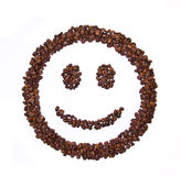 Smile shaped coffee beans. Isolated on white background Royalty Free Stock Images