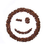 Smile shaped coffee beans. Isolated on white background Stock Photos