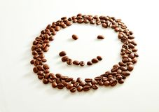 Smile shaped coffee beans isolated on white stock photography