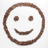 Smile shaped coffee beans isolated on white background. composition for bloggers, designers, websites. Smile shaped coffee beans isolated on white background Stock Photo