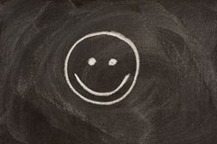 Smile sign on blackboard Stock Images